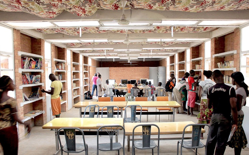 Katiou Library - the bookshelves are the part of the wall liberating more space