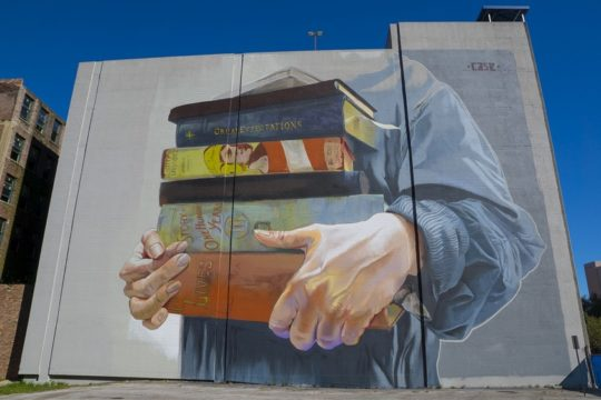 A stack of books mural by case maclaim in jacksonville florida