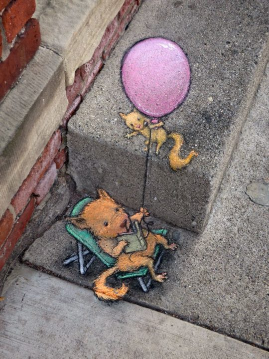 Mouse with a book and balloon - street lamp chalk artwork by David Zinn