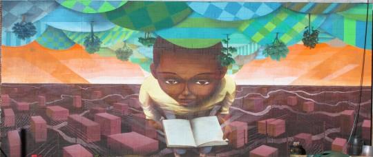 Arte de rua - Kid lê um livro