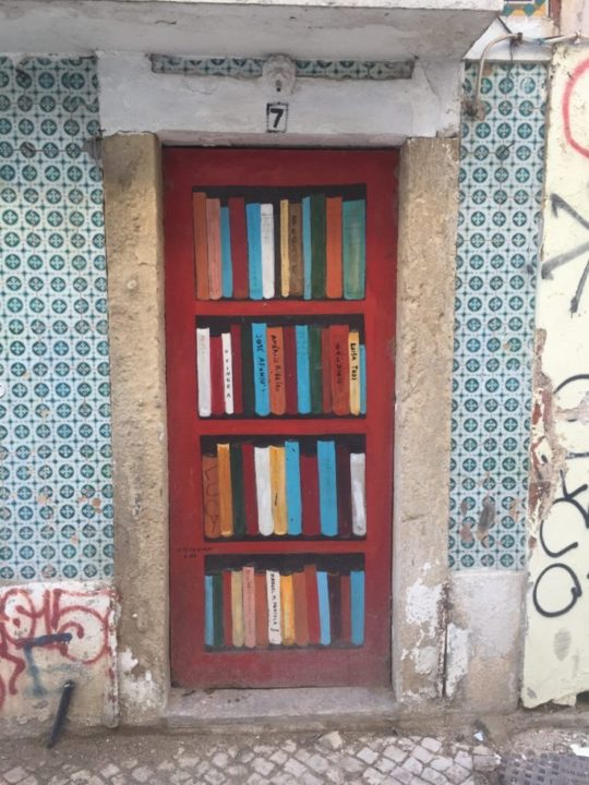 Street art in Setúbal, Portugal - bookshelf instead of the door