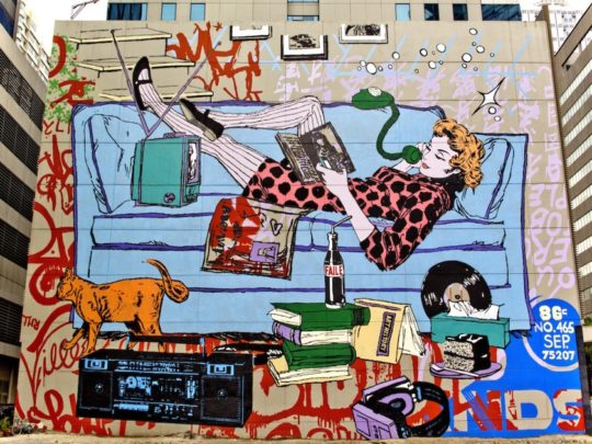 Woman reading on a sofa - a mural in Manila