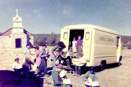 A bookmobile of Albuquerque Public LIbrary stops in Tijeras village, 1955