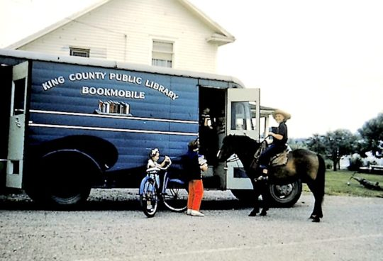 Children visiting King County Library System bookmobile, 1950s