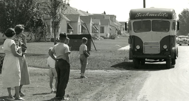 Impatiently waiting for the Saint Paul Public Library bookmobile, 1950s