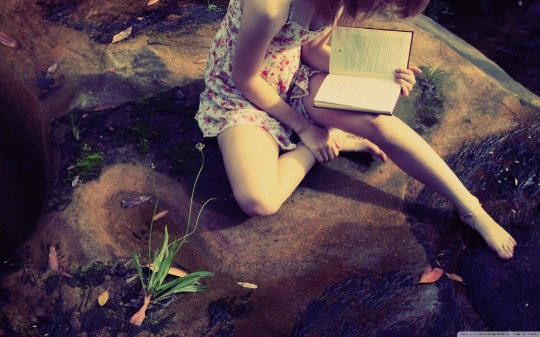Girl Reading a Book - a wallpaper for desktop computers,  laptops, tablets and smartphones