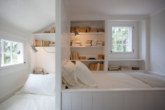 Bedroom with built-in reading nooks by Sullivan Building and Design Group
