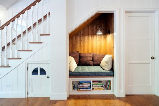 Reading nook under the stairs by JWT Associates