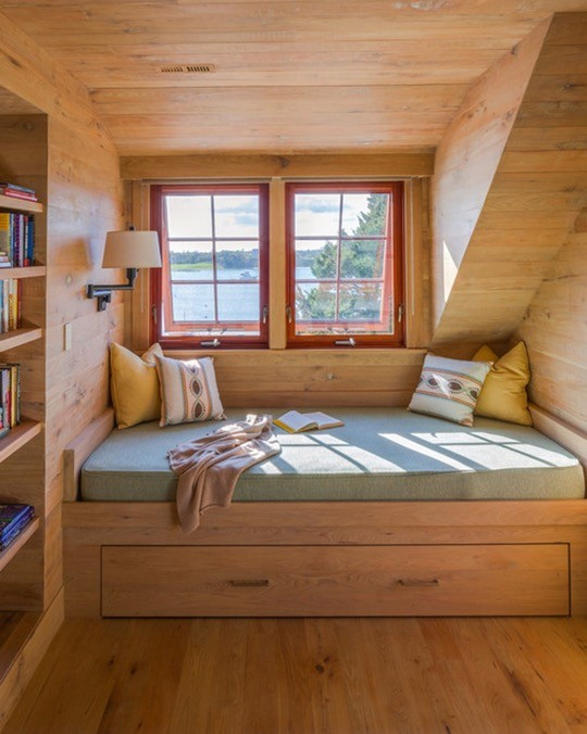 Rustic bedroom reading nook by Holmes Hole Builders