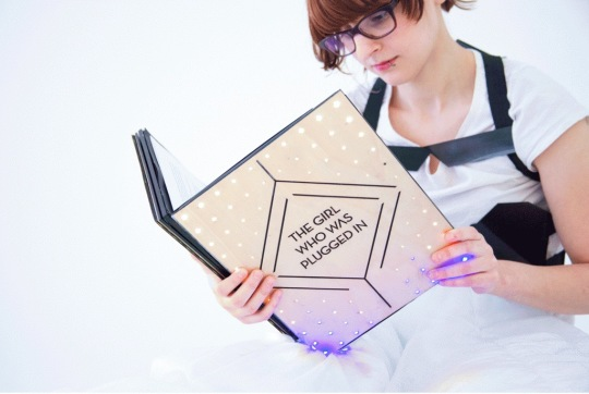 Sensory Fiction uses a concted print book and a wearable to let users  experience fiction in a totally new way