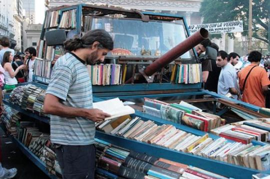 Weapons of Mass Instruction - a book tank that distributes free books on the streets of Buenos Aires