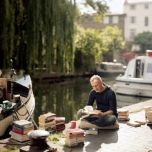 Reading a book near Word on the Water