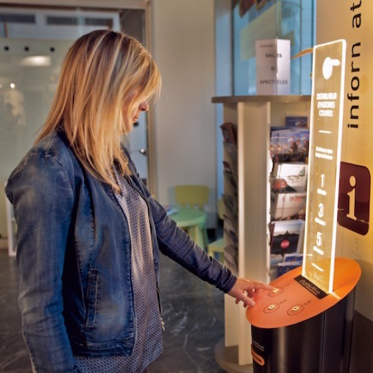 Short story vending machine in use