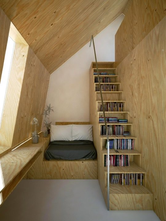 Scandinavian stairway library and reading nook