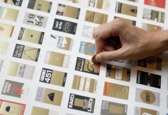 The poster from Pop Chart Lab lets you scratch scratch off the gold from the book covers