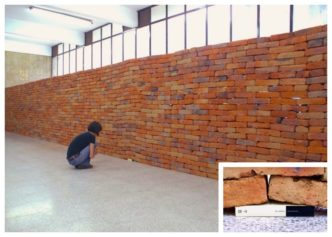 A single book deforms the entire wall of bricks - a stunning book installation by Jorge Méndez Blake