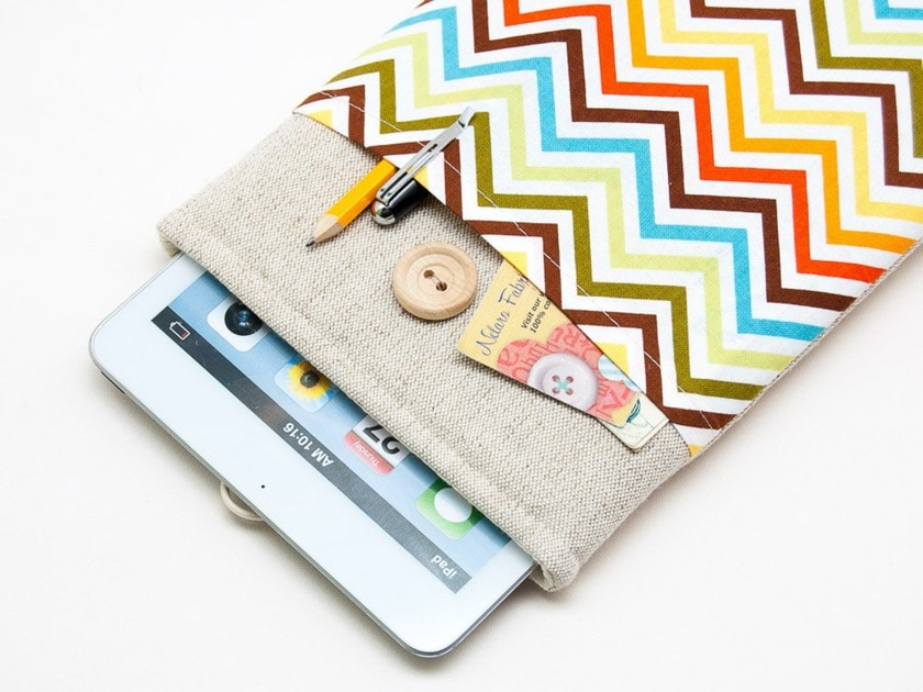 White linen Kindle sleeve with button closure