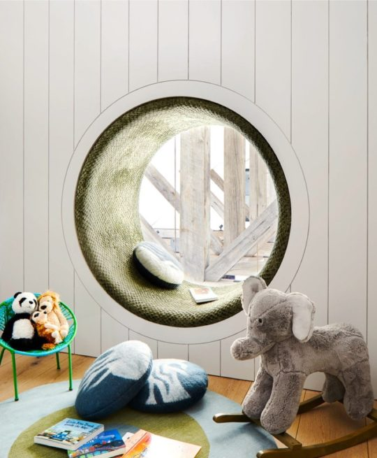 Round window reading nook for kids by Kevin O'Sullivan + Associates