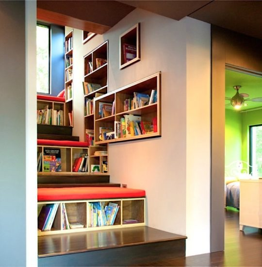 Staircase library and reading nook by Dialect