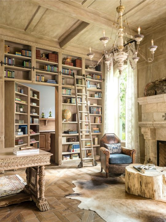 Mediterranean-style home library with hidden doors - home library ideas
