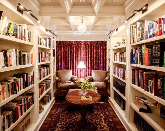 Traditional white burgundy family library design