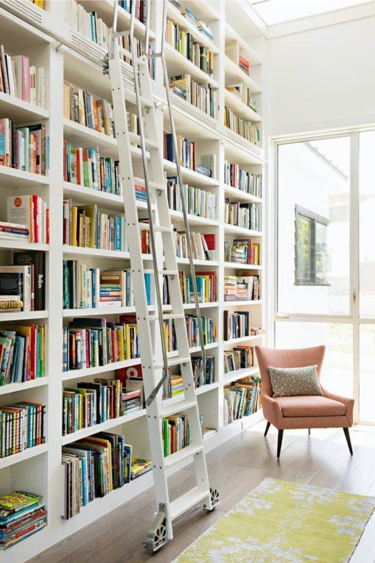 White library in a sunny family room - home library designs
