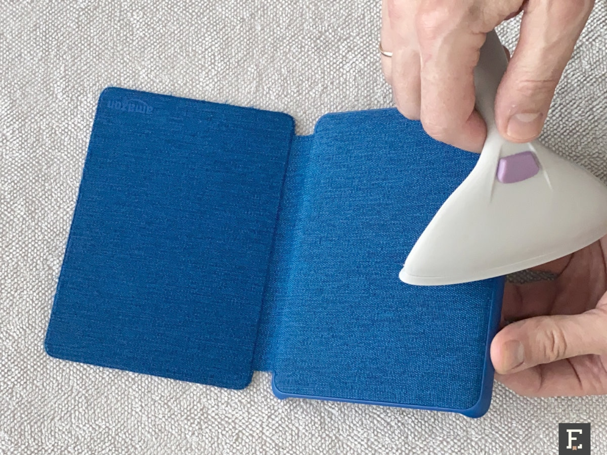 Use pet hair removal roller to clean fabric Kindle case
